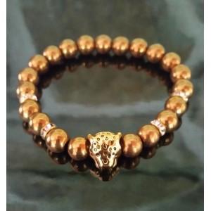 Hematit ve zlatém provedení s hlavou pantera